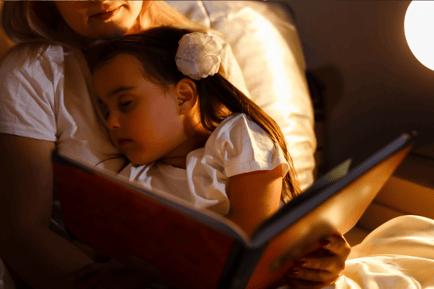 Toddler falling asleep on her Mum during story time