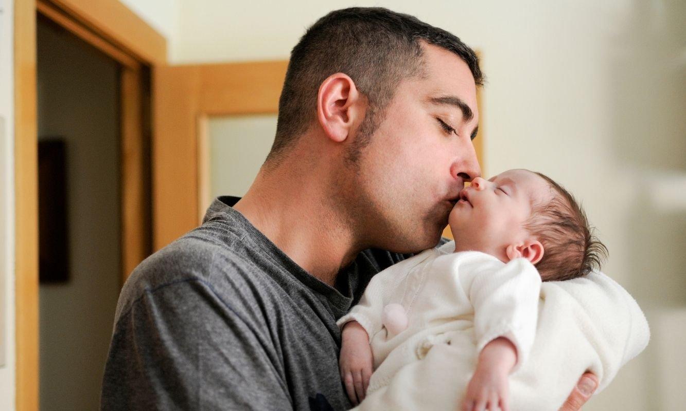 Dad with newborn child