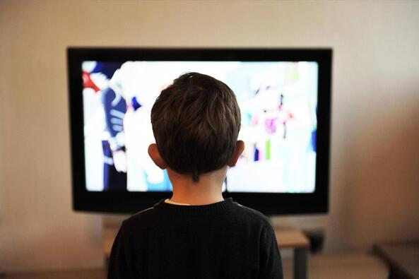 Toddler or Preschooler watching TV at home