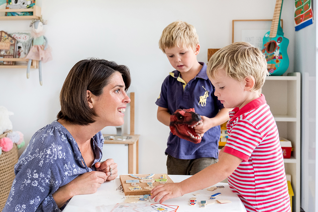 Photo of Occupational Therapist Rachel Carey and her two children playing together