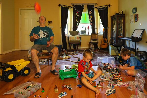 Dad in playroom with his sons lockdown