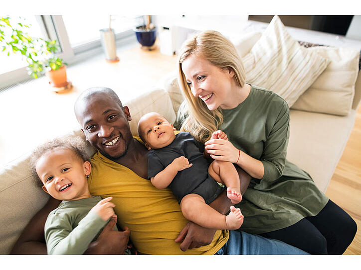 New parents spending time and forming a bond with their toddler and baby