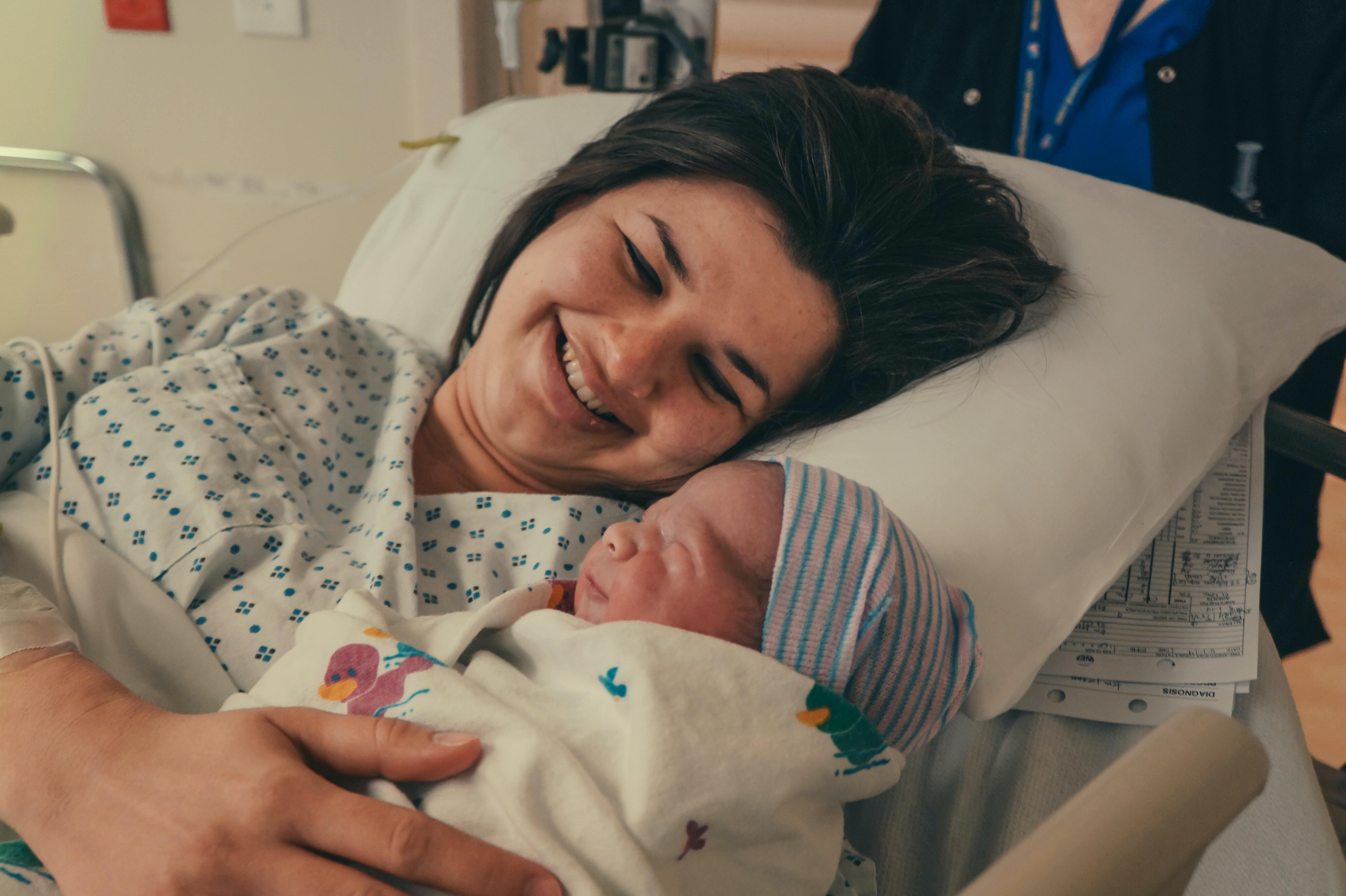 New mum holding her newborn baby