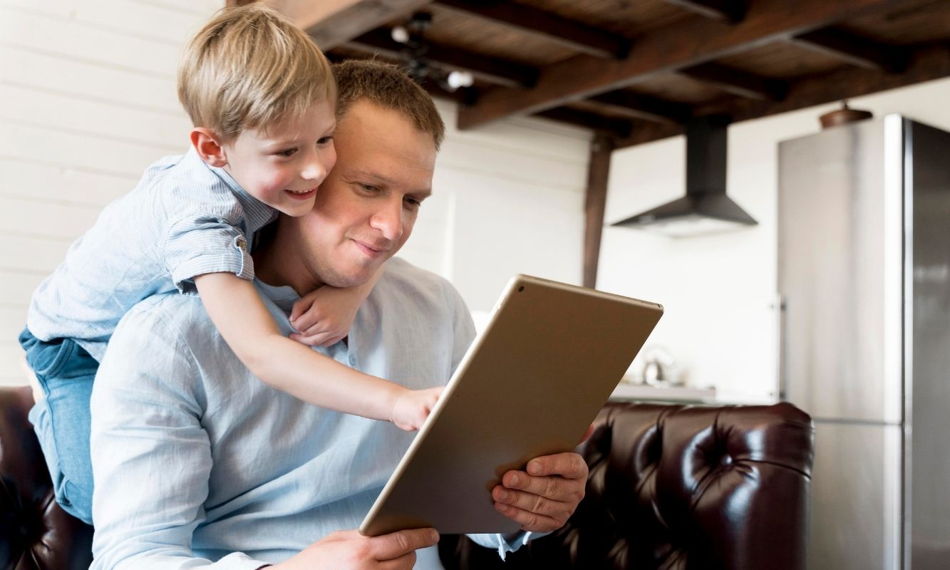 Dad and son looking at picture frame